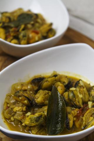 Muscheln in indischer Sauce